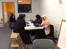 Somali women signing up for health coverage at the Abubakr Mosque in Tukwila