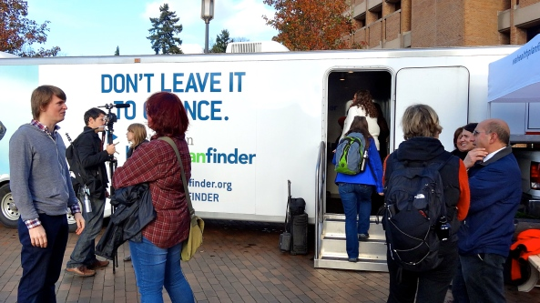 Death Cab For Cutie guitarist Chris Walla, left, talks to UW students about health insurance at WA Healthplanfinder's on-campus enrollment event