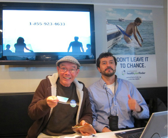 Chinh got help from Miguel of PHSKC inside the mobile enrollment trailer in Kent