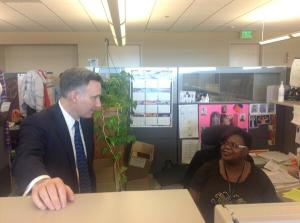 Executive Dow Constantine says thanks to Llonia Patterson of Public Health's Access & Outreach team