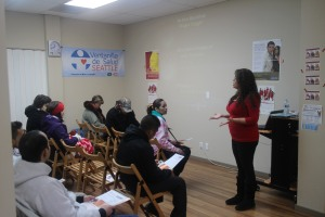 A presenter speaks to a group at the Seattle Mexican Consulate's Ventanilla de Salud, or Health Window.